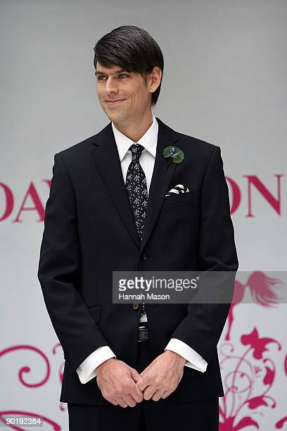 Angus Kennett in a Geoffrey Beene suit walks the catwalk at the David Jones Spring Racewear Launch at City Square on August 31 2009 in Melbourne...