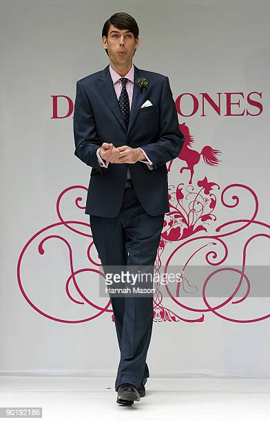 Angus Kennett in a Paul Smith navy suit walks the catwalk at the David Jones Spring Racewear Launch at City Square on August 31 2009 in Melbourne...