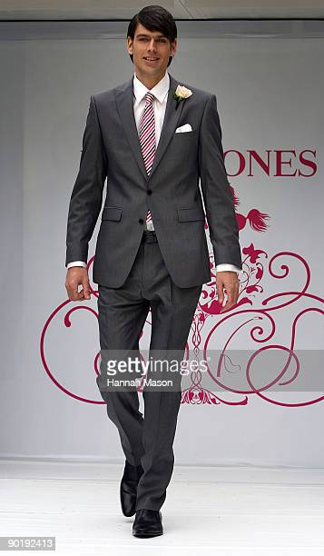 Angus Kennett in a Simon Carter 'West End' grey suit walks the catwalk at the David Jones Spring Racewear Launch at City Square on August 31 2009 in...