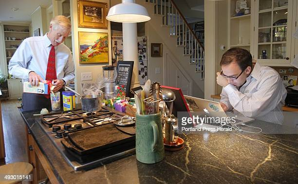 Angus King Independent candidate for US Senate mixes a breakfast drink before starting a day of campaigning on Tuesday October 23 2012 At right...