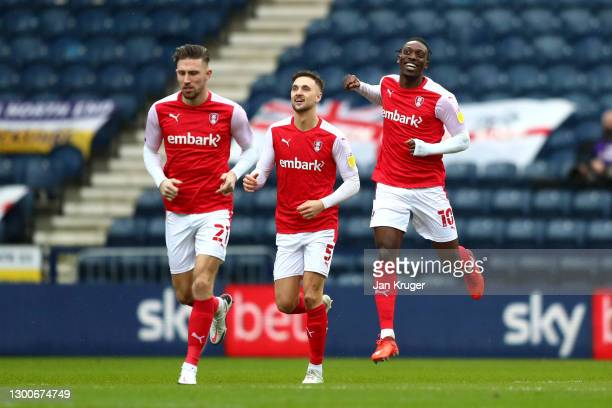 Angus MacDonald, Lewis Wing and Freddie Ladapo of Rotherham United celebrate after their team's first goal, an own goal by Joe Rafferty of Preston...