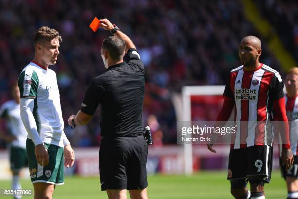 Angus MacDonald of Barnsley and Leon Clarke of Sheffield United are sent of during the Sky Bet Championship match between Sheffield United and...