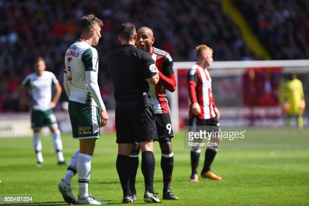 Angus MacDonald of Barnsley and Leon Clarke of Sheffield United are sent off during the Sky Bet Championship match between Sheffield United and...
