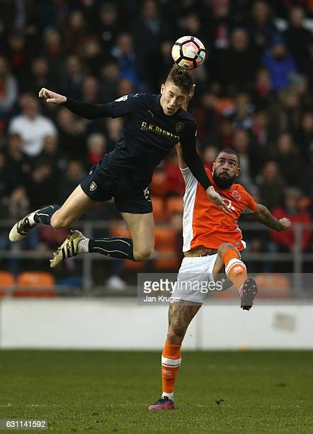 Angus MacDonald of Barnsley battles with Kyle Vassell of Blackpool during The Emirates FA Cup Third Round match between Blackpool and Barnsley at...