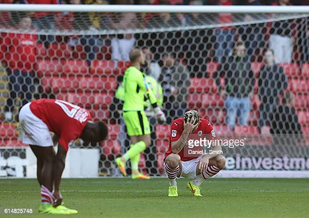 Angus MacDonald of Barnsley sits dejected after Barnsley were defeated by Fulham during the Sky Bet Championship match between Barnsley and Fulham at...