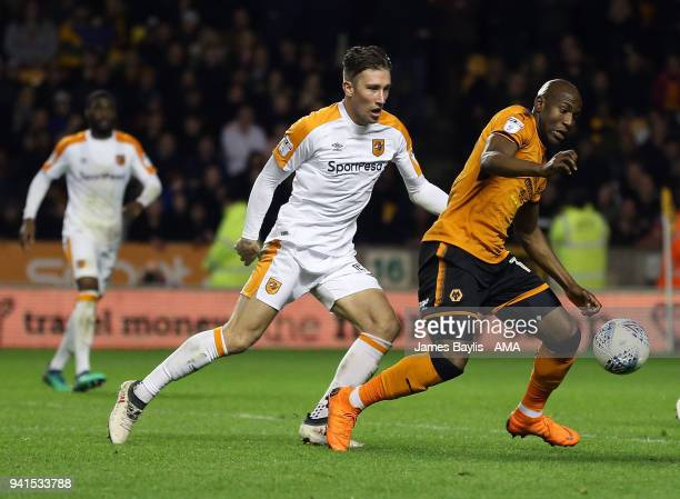 Angus MacDonald of Hull City and Benik Afobe of Wolverhampton Wanderers during the Sky Bet Championship match between Wolverhampton Wanderers and...