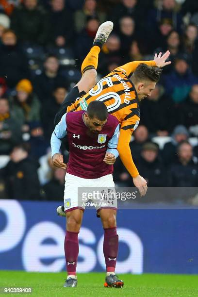 Angus MacDonald of Hull City clashes with Lewis Grabban of Aston Villa during the Sky Bet Championship match between Hull City and Aston Villa at...