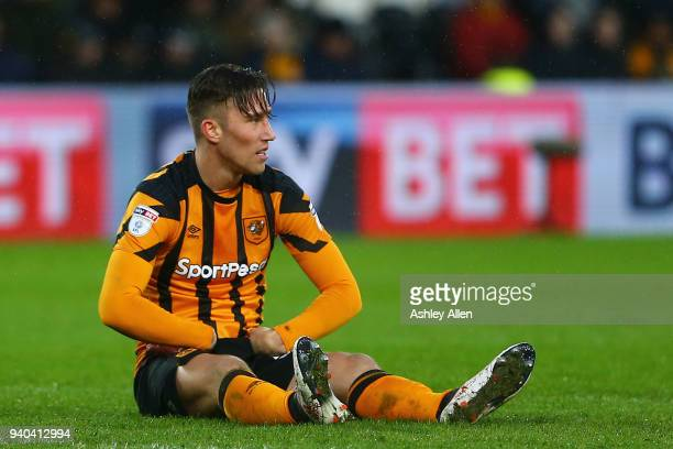 Angus MacDonald of Hull City is injured during the Sky Bet Championship match between Hull City and Aston Villa at KCOM Stadium on March 31 2018 in...