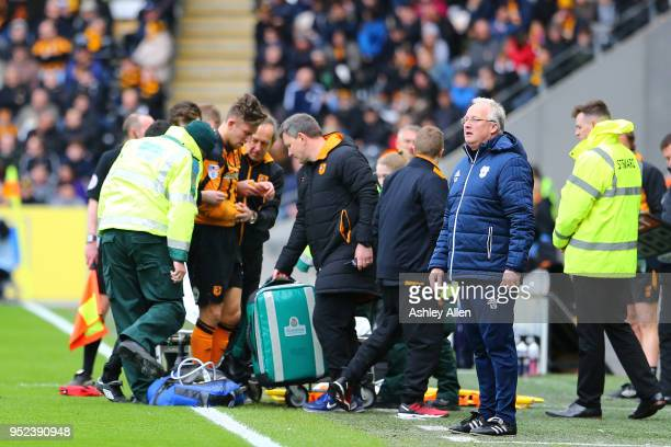 Angus MacDonald of Hull City leaves the field injured during the Sky Bet Championship match between Hull City and Cardiff City at KCOM Stadium on...