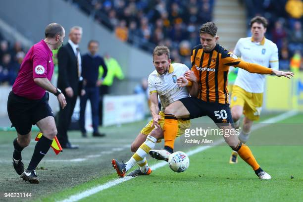 Angus MacDonald of Hull City wins the ball from Jordan Rhodes of Sheffield Wednesday during the Sky Bet Championship match between Hull City and...