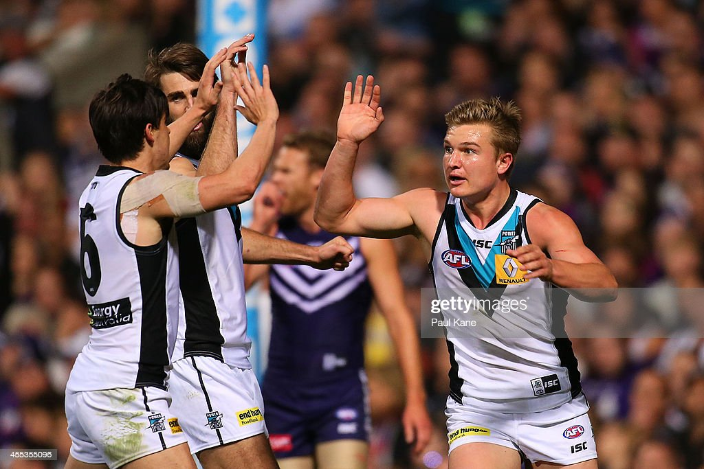 Angus Monfries and Ollie Wines of the Power celebrate a goal during the AFL 1st Semi Final match between the Fremantle Dockers and the Port Adelaide Power at Patersons Stadium on September 13, 2014 in Perth, Australia.