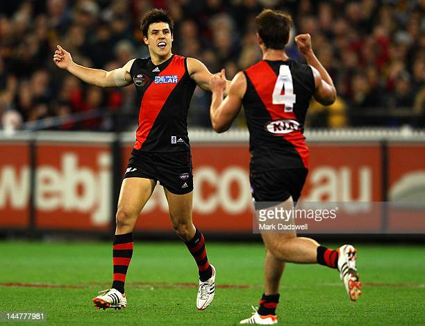 Angus Monfries of the Bombers celebrates a goal with Jobe Watson during the round eight AFL match between the Essendon Bombers and the Richmond...