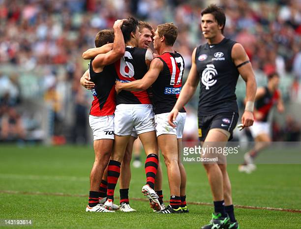 Angus Monfries of the Bombers celebrates a goal with teammates during the round four AFL match between the Carlton Blues and the Essendon Bombers at...