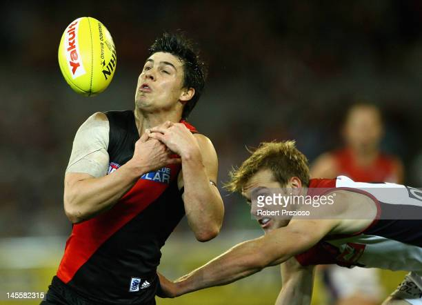 Angus Monfries of the Bombers flies for a mark during the round 10 AFL match between the Essendon Bombers and the Melbourne Demons at the Melbourne...