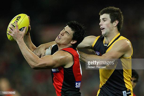 Angus Monfries of the Bombers marks under pressure during the round nine AFL match between the Essendon Bombers and the Richmond Tigers at Melbourne...