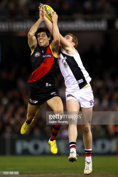 Angus Monfries of the Bombers marksinfront of Tom Lynch of the Saints during the round 18 AFL match between the Essendon Bombers and St Kilda Saints...