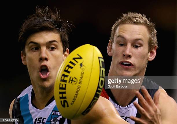 Angus Monfries of the Power and Jimmy Webster of the Saints compete for the ball during the round 17 AFL match between the St Kilda Saints and Port...