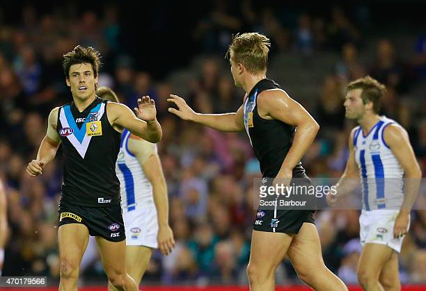 Angus Monfries of the Power celebrates after kicking a goal during the round three AFL match between the North Melbourne Kangaroos and the Port...