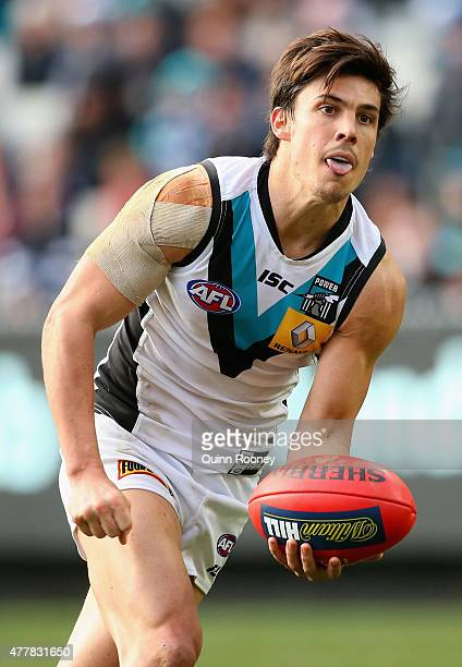 Angus Monfries of the Power handballs during the round 12 AFL match between the Carlton Blues and the Port Adelaide Power at Melbourne Cricket Ground...