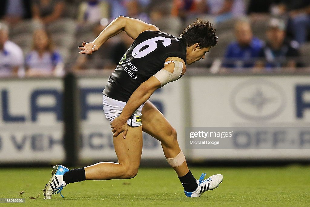 Angus Monfries of the Power injures his hamstring while running for the ball to an open goal during the round three AFL match between the North Melbourne Kangaroos and the Port Adelaide Power at Etihad Stadium on April 6, 2014 in Melbourne, Australia.