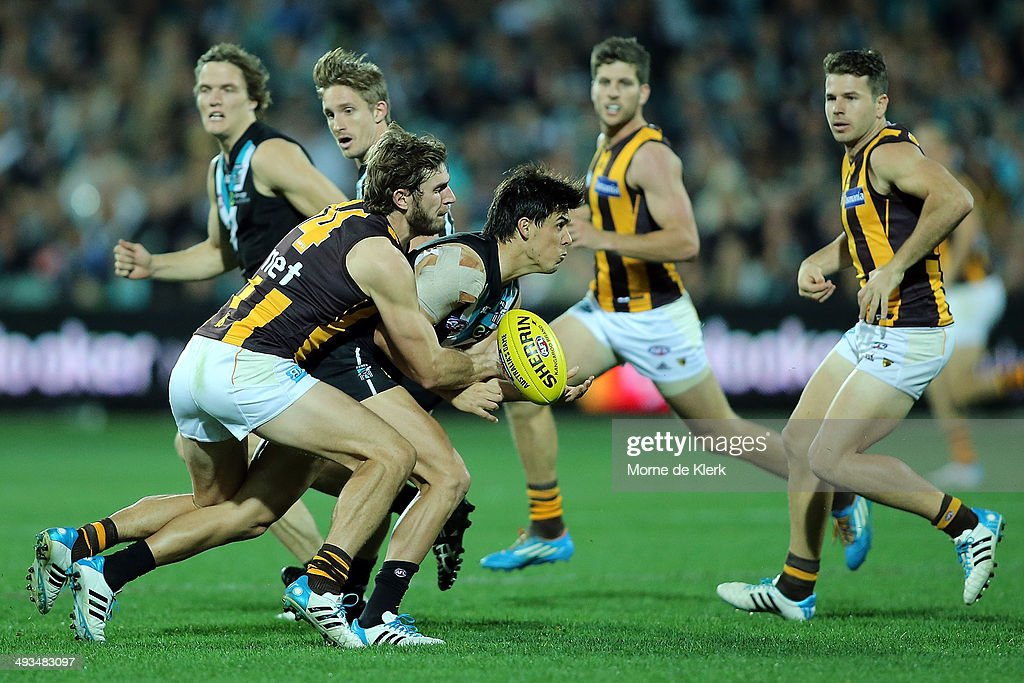 Angus Monfries of the Power is tackled by Grant Birchall of the Hawks during the round 10 AFL match between the Port Adelaide Power and the Hawthorn Hawks at Adelaide Oval on May 24, 2014 in Adelaide, Australia.