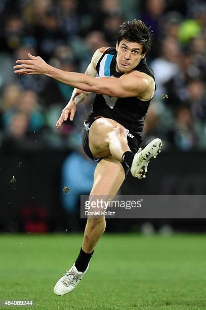 Angus Monfries of the Power kicks the ball during the round 20 AFL match between Port Adelaide Power and Greater Western Sydney Giants at Adelaide...