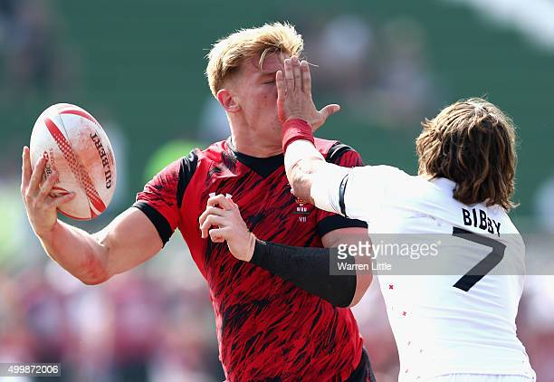 Angus O'Brien of Wales is tackled by Dan Bibby of England during the Emirates Dubai Rugby Sevens HSBC Sevens World Series at The Sevens Stadium on...