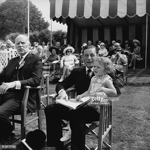 Angus Ogilvy husband of Princess Alexandra with their four year old daughter Marina on his knee at the 1970 Metropolitan Police Horse Show