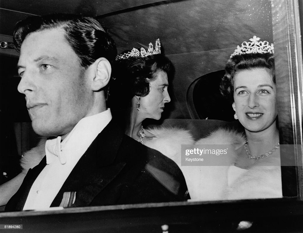 Angus Ogilvy, Princess Alexandra and Princess Marina leaving Kensington Palace in their limousine to attend a ball at Windsor Castle in their honour.