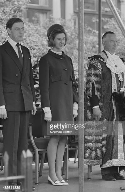 Angus Ogilvy with Princess Alexandra and Angus Ogilvy watching a festival of London Stores Parade in Hyde Park London 19th May 1968