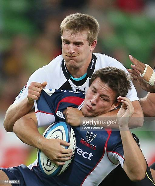 Angus Roberts of the Rebels is tackled by George Whitehead of the Kings during the round nine Super Rugby match between the Rebels and the Kings at...