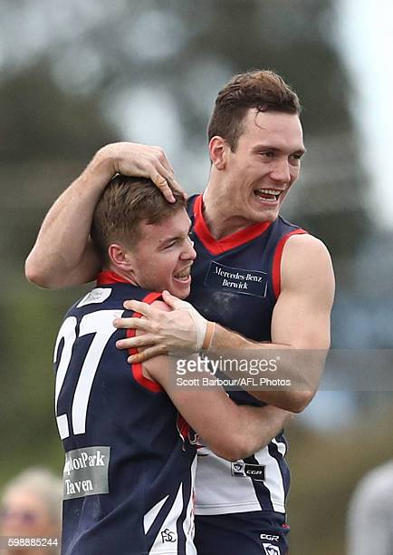 Angus Scott of Casey Scorpions is congratulated Liam Hulett and his teammates after kicking a goal during the VFL Qualifying Final match between...