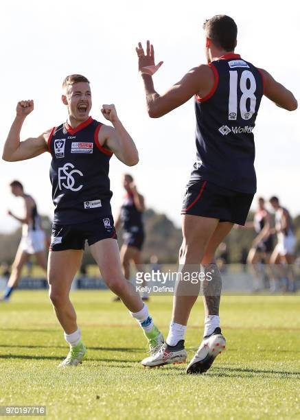 Angus Scott of the Demons celebrates his goal with Harley Balic of the Demons during the round 10 VFL match between Collingwood and Casey at Casey...
