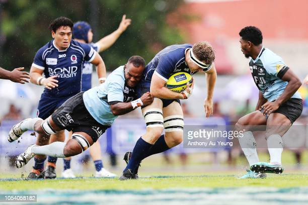 Angus ScottYoung of Queensland Country is tackled during the NRC Grand Final match between Fijian Drua and Queensland Country at Churchill Park on...