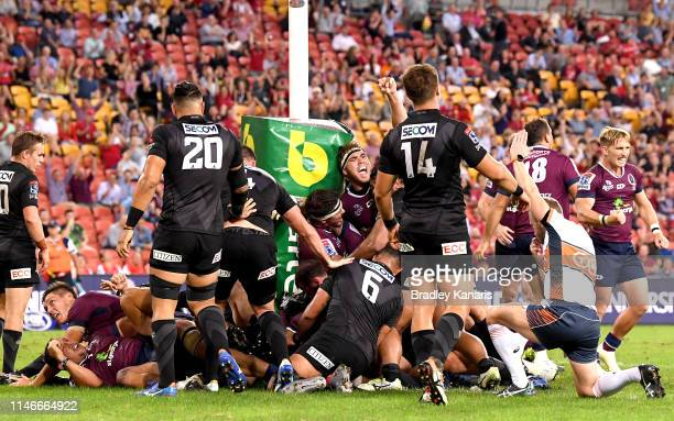Angus ScottYoung of the Reds celebrates a try by team mate Brandon PaengaAmosa during the round 12 Super Rugby match between the Reds and the...