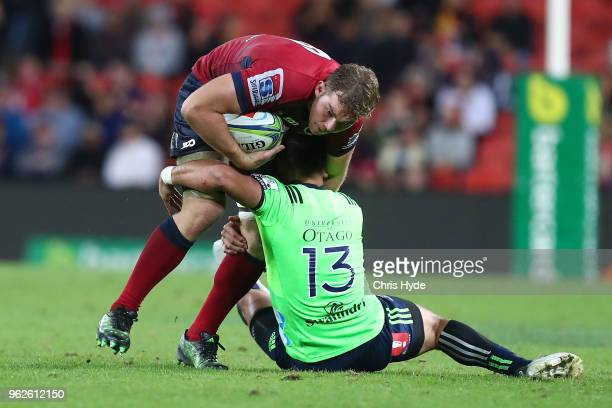 Angus ScottYoung of the Reds is tackled during the round 15 Super Rugby match between the Reds and the Highlanders at Suncorp Stadium on May 26 2018...