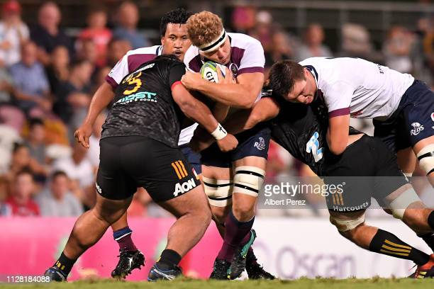Angus ScottYoung of the Reds is tackled during the Super Rugby preseason match between the Reds and the Chiefs at Ballymore Stadium on February 08...