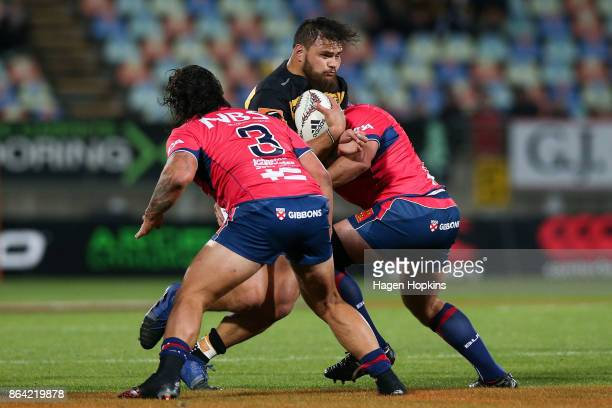 Angus Ta'avao of Taranaki is tackled during the Mitre 10 Cup Semi Final match between Taranaki and Tasman at Yarrow Stadium on October 21 2017 in New...