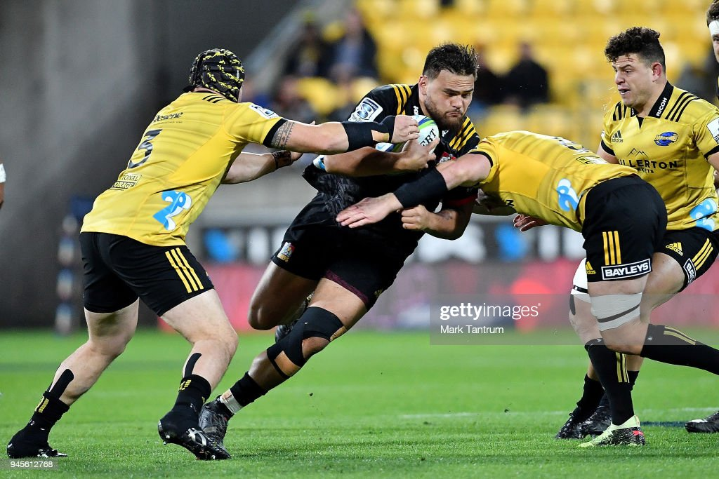 Angus Ta'avao-Matau of the Chiefs is tackled during the round nine Super Rugby match between the Hurricanes and the Chiefs at Westpac Stadium on April 13, 2018 in Wellington, New Zealand.