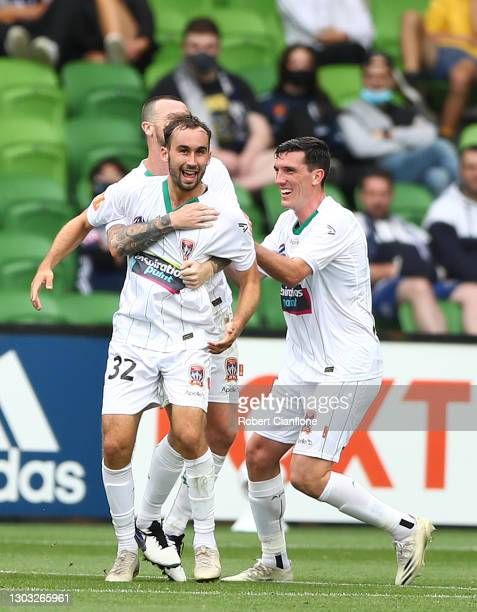 Angus Thurgate of the Jets celebrates after scoring a goal during the A-League match between the Melbourne Victory and the Newcastle Jets at AAMI...