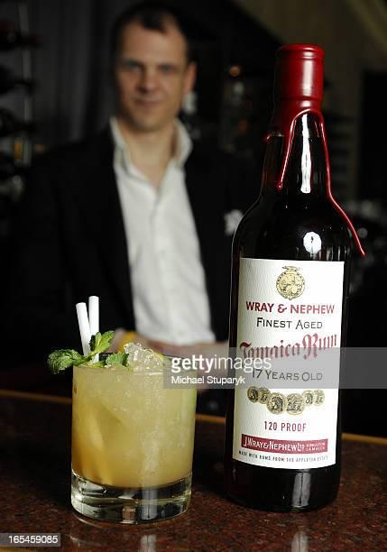 Angus Winchester with an original Mai Tai an exoensive cocktail