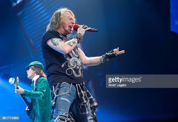Angus Young and Axl Rose of Guns N' Roses perform with AC/DC during the Rock Or Bust Tour at The Palace of Auburn Hills on September 9 2016 in Auburn...