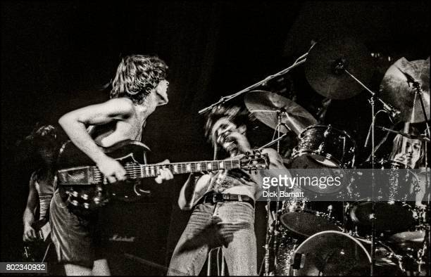 Angus Young and Bon Scott of AC/DC performing on stage Lyceum Theatre London United Kingdom on July 7 1976 from the Lock Up Your Daughters Tour