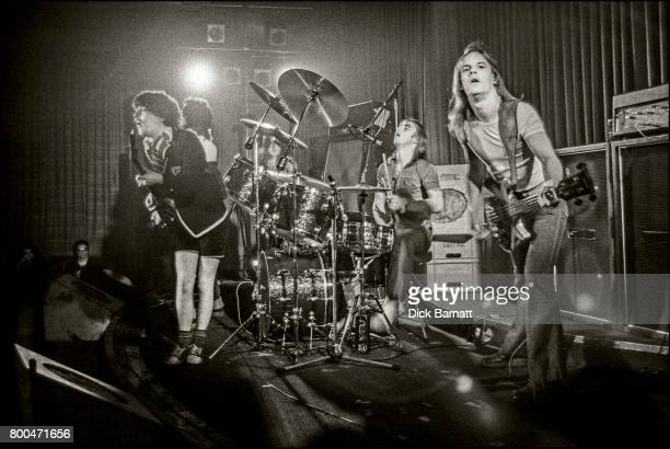 Angus Young and Mark Evans of AC/DC performing on stage Nashville Rooms London 27th May 1976
