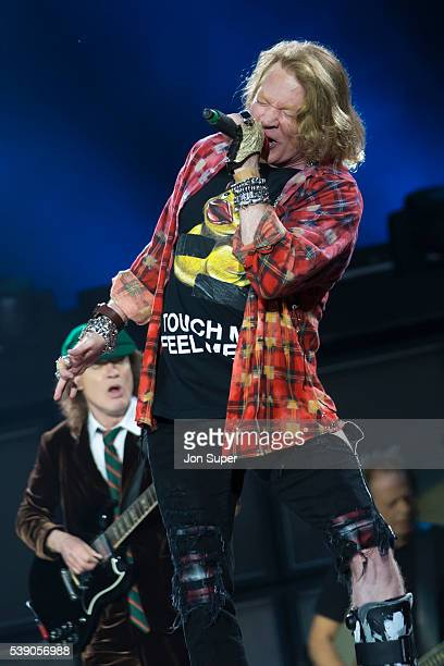 Angus Young Axl Rose and Stevie Young of AC/DC perform at the Etihad Stadium on June 9 2016 in Manchester England