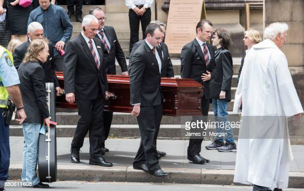Angus Young brother of Malcolm carries his guitar at the end of the funeral service for AC/DC cofounder Malcolm Young at St Mary's Cathedral on...