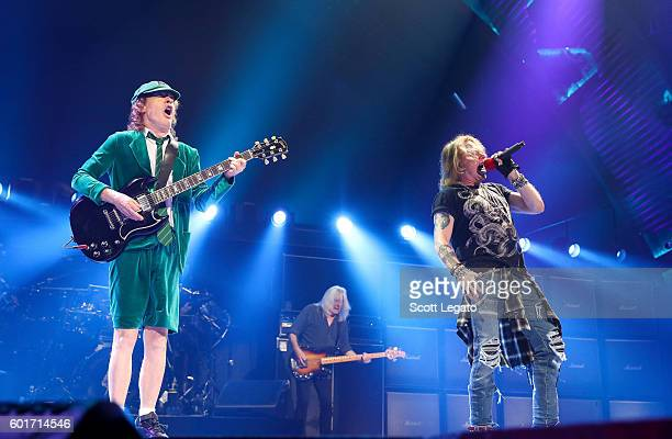 Angus Young Cliff Williams and Angus Young of AC/DC perform during the Rock Or Bust Tour at The Palace of Auburn Hills on September 9 2016 in Auburn...