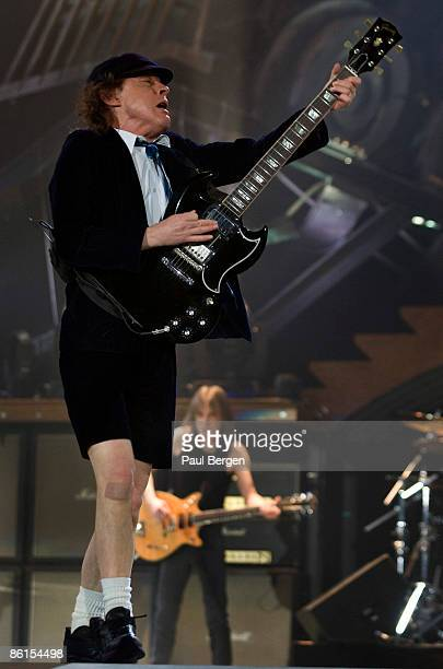 Angus Young of AC/DC performing on stage at Ahoy in Rotterdam Holland on March 13 2009 Malcolm Young behind