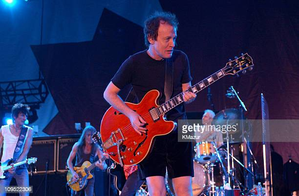 Angus Young of AC/DC plays with The Rolling Stones