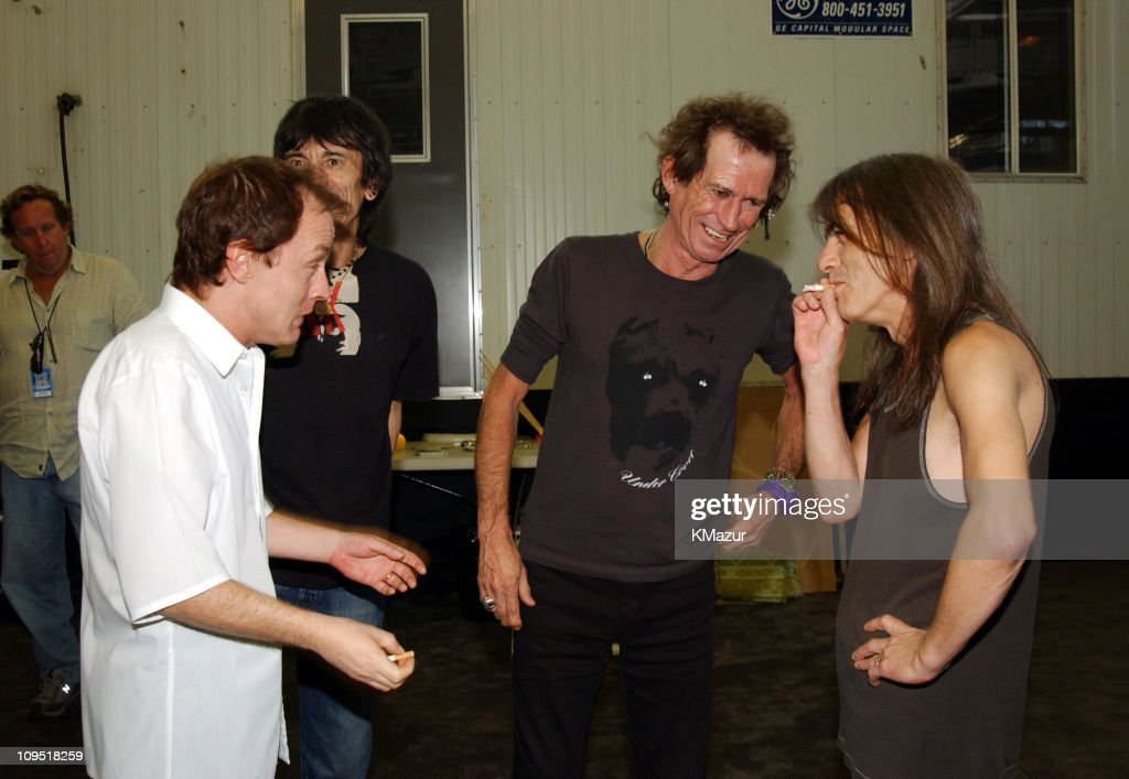 Angus Young of AC/DC, Ron Wood and Keith Richards of The Rolling Stones with Malcolm Young of AC/DC
